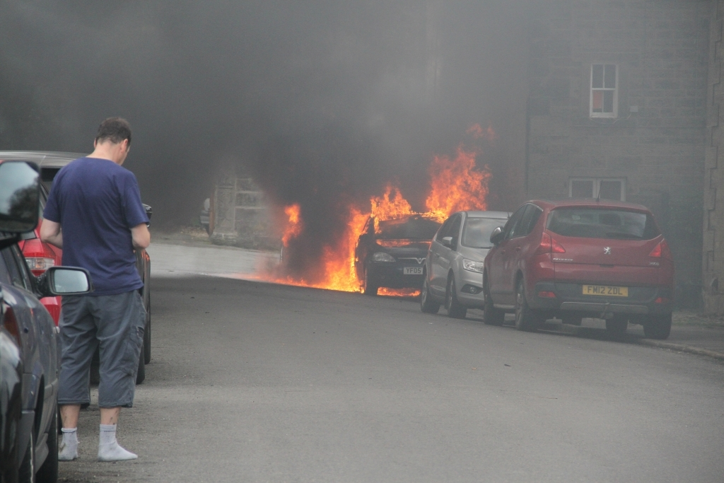 Car on fire in Winster